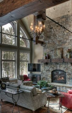 Love the volume and stone fireplace