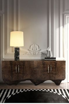 Huang is a mountain range in eastern China known for its spectacular scenery. Inspired by this magnificence, our designers created HUANG Sideboard by BRABBU. It features an outside in walnut root veneer, an inside in rosewood veneer and details in matte hammered brushed aged brass. This wood sideboard brings instant character to modern interior design.