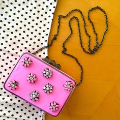 Like Dreams clutch crossbody with gems Well made clutch with pink vinyl exterior and rhinestone flowers. No gems missing, great condition. Can be used as a crossbody bag or a clutch. Clasp opening with one interior pocket. Purchased from Nasty Gal. Nasty Gal Bags Crossbody Bags