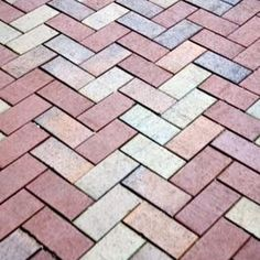 Colorful pavers add intricacy to a herringbone pattern.
