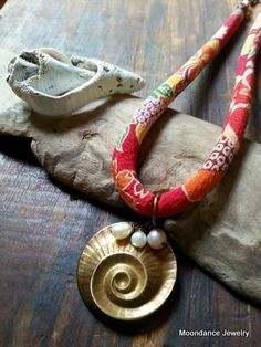 Funky mixed media necklace from Nadine Edris, the snail shell is from bsueboutiques.com