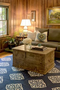 An old trunk anchors this setting within a gorgeous wood paneled room.