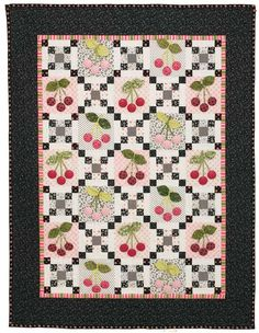 """Black Cherries, 55 x 71"""", free quilt pattern by Holly Holderman at McCalls Quilting. Dimensional appliqued leaves and covered-button cherries."""