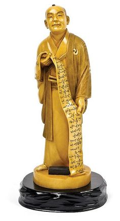 A Japanese stained ivory okimono, Taisho period, (1912-1926) of a standing monk. Provenance: from the Estate of Sir Eugene Gorman and Dr Pierre Gorman
