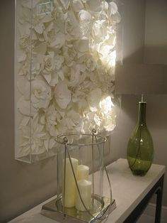 Genius - spray paint faux flowers one color and attach to a canvas and cover with clear box frame
