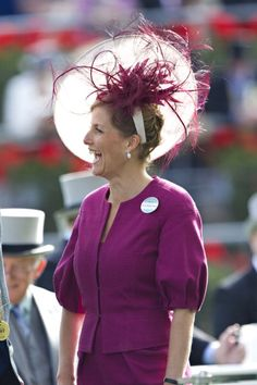 Sophie, Countess of Wessex.  Simply awful colour.  Ridiculous style outfit. Daft & odd hat. Yugh! Sophie.
