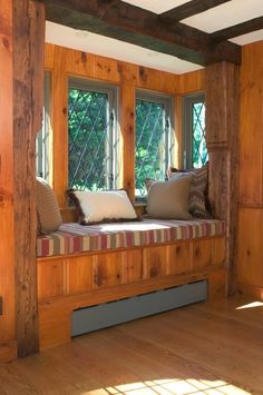 Love this knotty pine book nook!