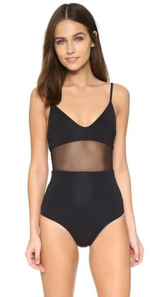 Black Mara hoffman  swimsuit  for woman A sheer mesh panel sits below the bodice of this Mara Hoffman one piece swimsuit. Adjustable shoulder straps. Lined. 80% nylon/20% spandex. Hand wash. Made in the USA. Imported fabric. Available sizes: S #bathingsuit