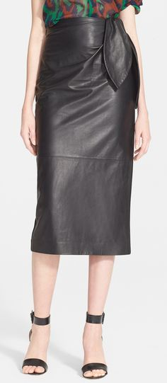 Totally obsessed with this chic leather DVF skirt that features wide petals and a ruched waist.