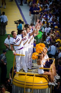 Tradition~The LSU Cheerleaders riding atop Mike the Tiger's cage. They take a lap around the football field before each game begins. Then Mike waits for the opposing team to run out on the field right past him.  Rather intimidating, I'd say, to have to pass by the roaring LSU mascot!  Geaux Tigers!
