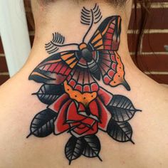 lower back neck tattoo butterfly with flower traditional style