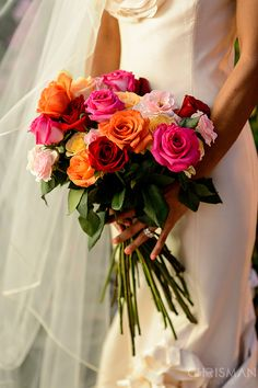 I love how these look freshly picked from a garden  bouquet roses pink, orange, red    www.apollinas.com