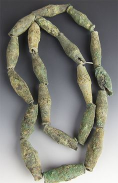What an extremely cool strand of ancient metal beads. We can't tell you very much about these -- but they appear to be ancient bronze, most likely from somewhere around Mali. Are they hundreds of year