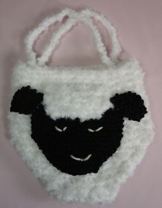 "Children's Sheep Purse - This is so cute, even teens and moms will want one!  Finished size is about 7"" by 6"" inches. A cute Easter purse! This works up easy with textured yarn in worsted weight.  Also uses knitting needles US #8.  This is quite easy, and most folks can knit one in an afternoon! The children love putting small toys, crayons and small tablets in this to carry to Grandma's house.  You can buy the "" googly"" eyes to sew on or embroider on eyes as we did.  $1.75"