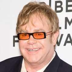 """Elton John is a British singer, pianist and composer whose unique blend of pop and rock styles turned him into one of the biggest music icons of the 20th century. He excelled in music from a young age, attending the prestigious Academy of Music on a scholarship at just eleven years old. In 1970 he released his first self-titled American album, making him a huge international star. Some of his most famous hits include """"Crocodile Rock,"""" """"Philadelphia Freedom,"""