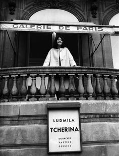 1962. Ludmilla Tchérina stands on the balcony of the Galerie de Paris, where an exhibition of her gouaches, pastels and drawings is being held.