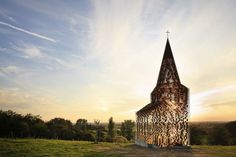 From inside the Gijs Van Vaerenbergh-designed art church known as Reading Between The Lines the natural sunlight hits the ground in a noiris...