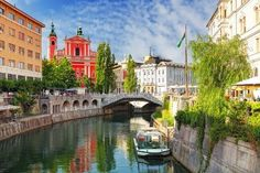 Take a city break off the beaten track in Slovenia and discover the charms of Ljubljana. #travel #Canal #Architecture