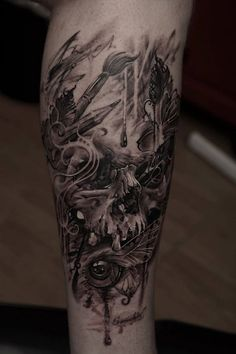 Artistic skull with a lot of symbols on man's calf