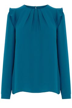 This pretty little blouse is the perfect way to add a little bit of cute into your wardrobe. With its long sleeves and loose shape we know this will be a cosy one, and we love the sweet frilled shoulder and pleated neckline that takes this blouse to the next level.