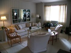 Interior Photos of Lustron Homes | The living room, with original shelving and mirror.