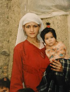 Pashtun Afghan women with her child