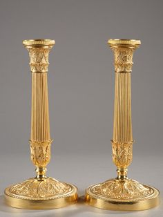 Pair of ormolu candlesticks finely chiselled with palmette and acanthus leaves at the base and top. The fluted stem fits into the lower part ornate with acanthus leaves. Very beautiful...
