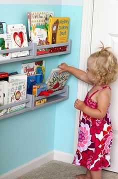 $4 Ikea spice racks as kids book holders. Perfect for behind the door.