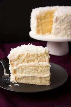 Coconut Cake - this is one of the best cakes Ive ever made! So soft and tender and perfectly moist. Love the coconut cream cheese frosting too.