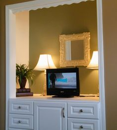 Neat idea--remove closet door(s), paint a coordinating but diff. color than surrounding wall (or wallpaper, stencil design, ect.), add built-in storage on bottom, mount or sit flat-screen tv inside, add decor accessories if needed :)