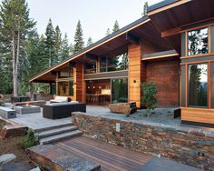 Exotic Mountain House Using Exotic Wooden Material and Natural Stone : Sleek Mountain Modern Digs Exterior With Modern Patio Furniture