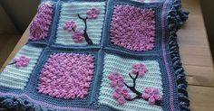 How to Make a Cherry Blossom Crochet Blanket       In this craft work done in crochet. The bet was to use a more closed stitch along the ba...
