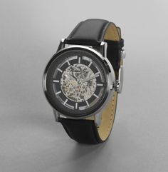 Kenneth Cole Stainless Steel Watch, 4clicks per second, face and back exposed gears $150.00