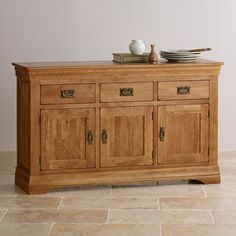 The French Farmhouse Rustic Solid Oak Large Sideboard is a comprehensive storage unit with an exclusive design inspired by antique French furniture.