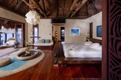 Stylish Overwater Bungalows at Luxury Resorts Around the World Photos | Architectural Digest