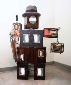 Nam June Paik (South Korean, active U.S., 1932-2006), Beuys Voice. Two channel color video on laser discs, antique television cabinets, felt, mixed media sculpture, 1990. 104 3/8 x 74 x 37 3/8 in. Toledo Museum of Art, 2015. Part of the summer exhibition Play Time.