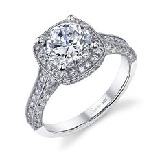 This romantic vintage inspired engagement ring features a carat round brilliant diamond in a cushion shape halo of channeled diamonds with milgrained details which flows onto the shank for a total of carats. Vintage Inspired Engagement Rings, Cushion Cut Engagement Ring, Classic Engagement Rings, Platinum Engagement Rings, Beautiful Engagement Rings, Wedding Rings Vintage, Antique Engagement Rings, Wedding Bands, Oval Engagement