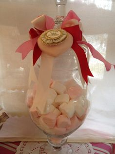 We used pink and white marshmallows to fill apothecary jars for a Valentine display.  We'd use this for a bridal shower or on the sweets table at a pink themed wedding as well.