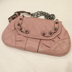 Juicy Couture pink leather and silver wristlet Very gently used Juicy Couture wristlet. Features a pewter silver bracelet with heart clasp, embossed studs and interior card holder with 3 slots. Fits iPhone 5 or 6 with plenty of space for extras. Juicy Couture Bags Clutches & Wristlets