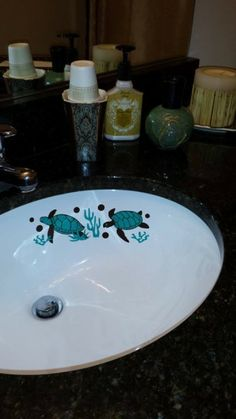 Sea Turtles beautifully decorate this sink in Georgia. Thanks for sending in the pic, Lisa! Bathroom Decals, Gypsy Living, Sink In, Sea Turtles, Shower Doors, Mailbox, Georgia, Lisa, Design