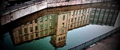 The Italianate building at The Locks reflected in the canal.
