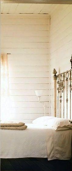 vintage bed frame | high ceiling | wood paneled walls