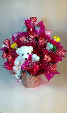 Tens of chocolate hearts with a lovely teddy bear.