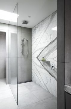 As the master bathroom at moves forward quickly, I'm looking into bathroom tile accent wall options at every free moment. Tile Accent Wall, Bathroom Accent Wall, Marble Tile Bathroom, Bathroom Accents, Contemporary Bathrooms, Contemporary Interior Design, Modern Bathroom, Master Bathroom, Modern Design