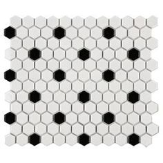 """Perfect as a backsplash in the kitchen or powder room, this glazed porcelain tile showcases a black and white hexagon motif.   Product: Set of 10 tile mosaicsConstruction Material: PorcelainColor: White and blackFeatures:  Easy to installMesh-mountedGreat for use on floors and backsplashes Set covers 8.54 square feet 0.19"""" Thickness 0.0625"""" Recommended grout width  Dimensions: 12"""" W x 10.25"""" D each"""
