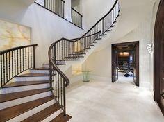 Pin for Later: LeBron James Just Sold the Most Incredible Pool in America There is a grand entryway with a sweeping staircase. Lebron James, King Lebron, Grand Entryway, Entry Foyer, Entrance Hall, Marble Foyer, Inside The Nba, Florida Mansion, Wrought Iron Stairs