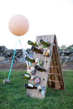 unique guestbook idea - leave a note in a wine bottle for the couple! photo by Lens CAP Photography http://ruffledblog.com/new-england-vineyard-wedding #weddingideas #guestbooks