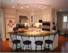 Country Kitchen Islands with Seating | French Country Kitchen Island by Rogers Cabinets at CustomMade.com