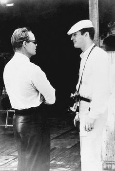 Marlon Brando talks with Paul Newman on the set of Brando's film The Fugitive Kind in Milton, New York, 1959 Newman's wife Joanne Woodward was one of the stars of The Fugitive Kind