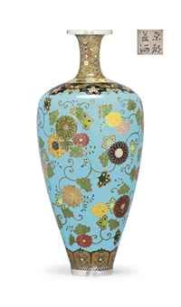 A Fine Cloisonné Vase Signed on a silver tablet Kyoto Namikawa, Meiji Period (late 19th century) Worked in various thicknesses of silver wire and coloured cloisonné enamels with chrysanthemum flowers and scrolling vines and leaves against and light blue ground, stylised butterflies and flowers to the shoulder, shippo-hanabishi to the neck and floral lappets to the foot, silver rims